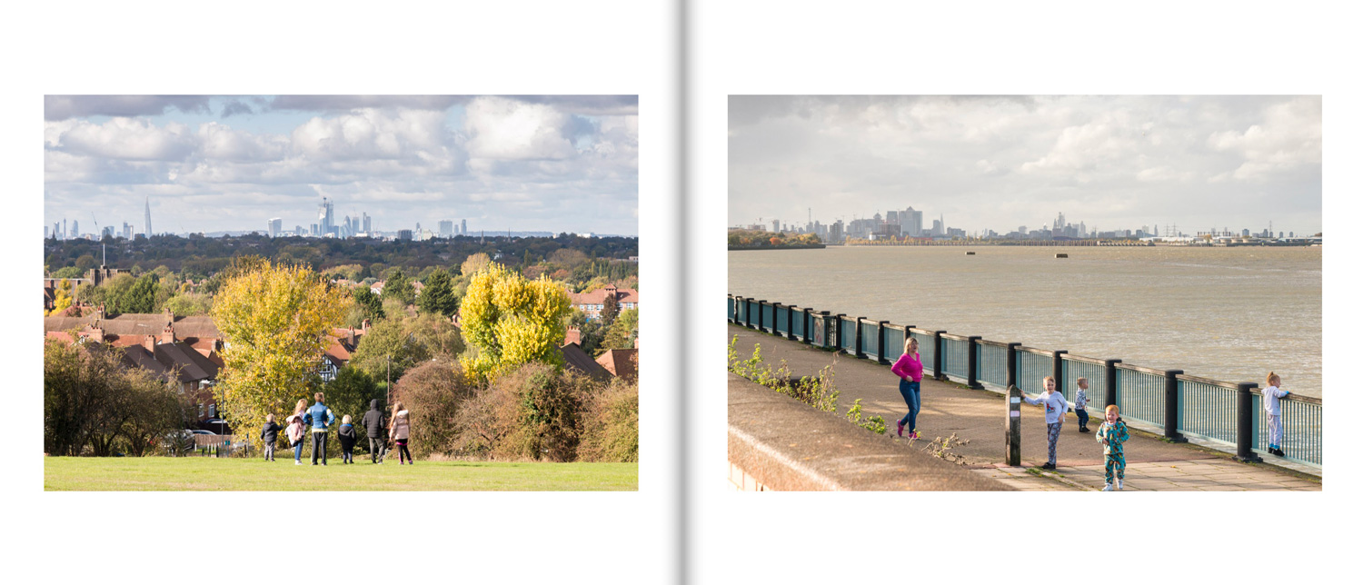 a sample spread from the book shows two landscape photos, in the left hand one, a grup of fairly young children look at the towers of the City of London in the distance. In the right photo, a mother with young family walk by the Thames estuary, in the distance are the buildings of Canary Wharf.